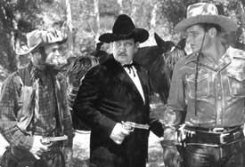 El villano eterno, Charles King, al centro con Al Fuzzy Jones y Buster Crabbe (der.) en