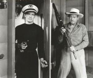 Kane Richmond con Roy Barcroft en el serial