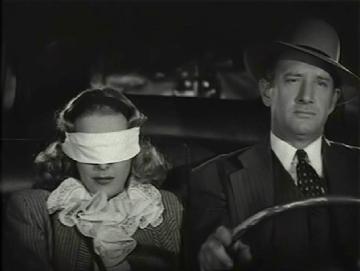 Jack Ingram y Joan Woodbury en una escena de Brenda Starr, reporter